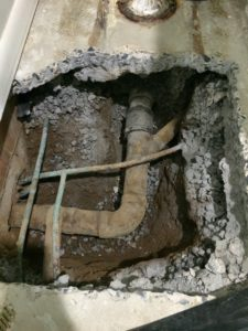 This customer had a leaking pipe underneath the cement floor of his bathroom.  So I cut it up and exposed the pipes.
